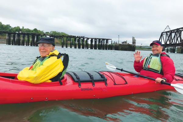 A resident from The Highlands Gracious Retirement Living in Westborough, Massachusetts in a kayak