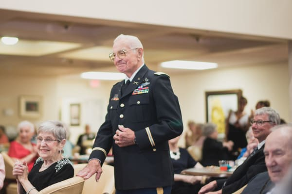 A veteran resident in his uniform at The Oaks Gracious Retirement Living in Georgetown, Texas