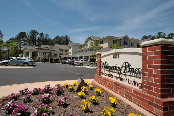 The main sign outside of Whispering Pines Gracious Retirement Living in Raleigh, North Carolina