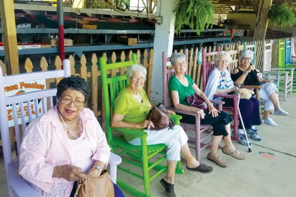 Residents from Willow Creek Gracious Retirement Living in Chesapeake, Virginia sitting on chairs