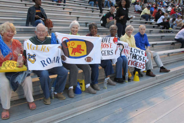 Residents from Willow Creek Gracious Retirement Living in Chesapeake, Virginia at a football game
