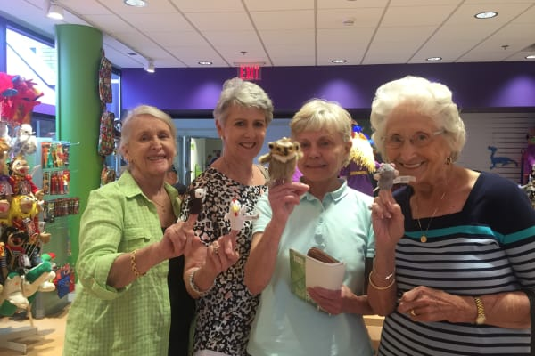 Residents from Willow Creek Gracious Retirement Living in Chesapeake, Virginia with finger puppets