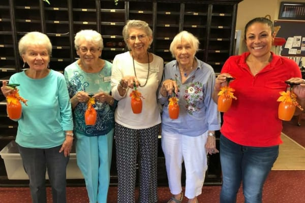 Residents holding their decorated cups at Mulberry Gardens Assisted Living in Munroe Falls, Ohio
