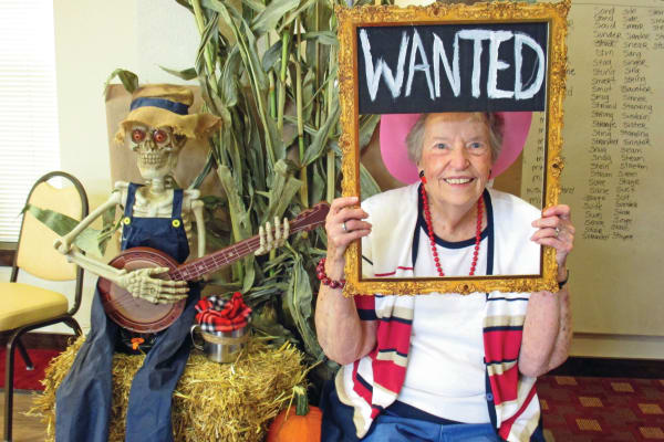 A resident holding a wanted sign at Mulberry Gardens Assisted Living in Munroe Falls, Ohio