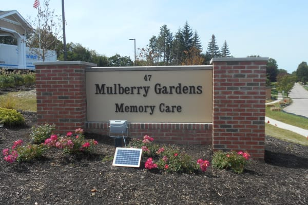 The main sign at Mulberry Gardens Memory Care in Munroe Falls, Ohio