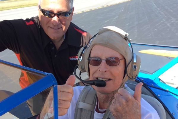 A resident from Palms at Bonaventure Assisted Living in Ventura, California in an airplane