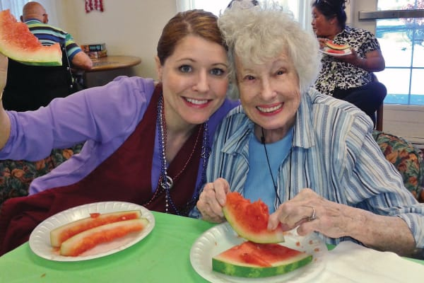 A resident eating watermelon at Palms at Bonaventure Assisted Living in Ventura, California