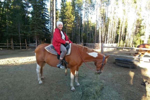 A resident from Stoneybrook Assisted Living in Corvallis, Oregon riding a horse