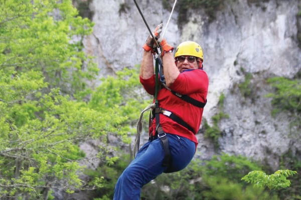 A resident from Stoneybrook Assisted Living in Corvallis, Oregon zip lining