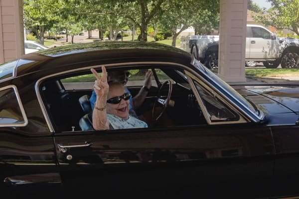 A resident in a classic car at Stoneybrook Assisted Living in Corvallis, Oregon