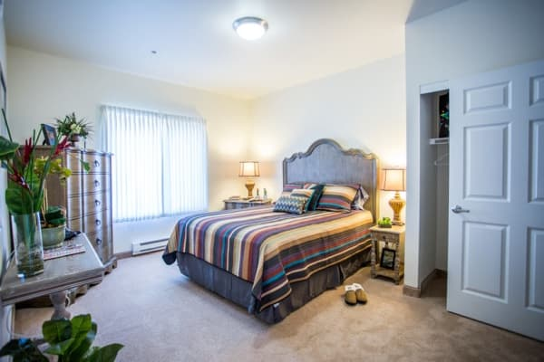 A spacious bedroom at The Palms at La Quinta Assisted Living and Memory Care in La Quinta, California