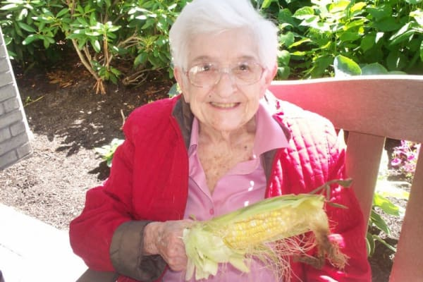 A resident eating corn on the cob at The Palms at La Quinta Assisted Living and Memory Care in La Quinta, California