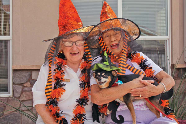 Two residents and a dog at The Palms at La Quinta Assisted Living and Memory Care in La Quinta, California