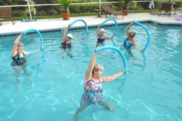 Residents exercising in the pool at The Palms at La Quinta Assisted Living and Memory Care in La Quinta, California