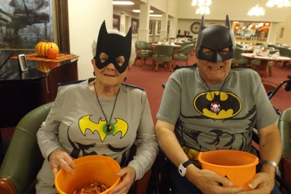Two residents handing out candy on Halloween at Winterberry Heights Assisted Living in Bangor, Maine