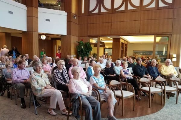 Residents at All Seasons Naples in Naples, Florida enjoying the show