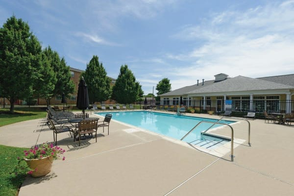 Swimming pool on a sunny day at Hill Brook Place Apartments in Bensalem, Pennsylvania