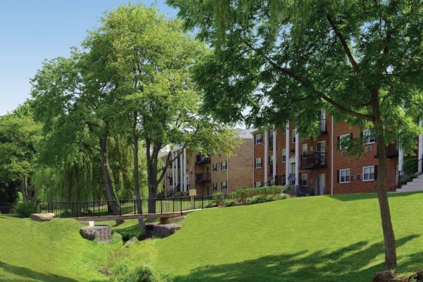 Landscaped grounds around Hill Brook Place Apartments in Bensalem, Pennsylvania