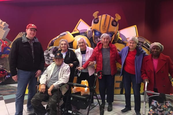 Residents at a movie theater near Heritage Green Assisted Living in Mechanicsville, Virginia