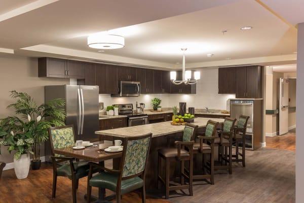 Dining area and kitchen at Avenir Memory Care at Nanaimo in Nanaimo, British Columbia.