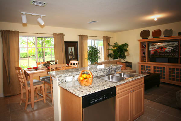 Kitchen and dining space at Green Cay Village in Boynton Beach, Florida