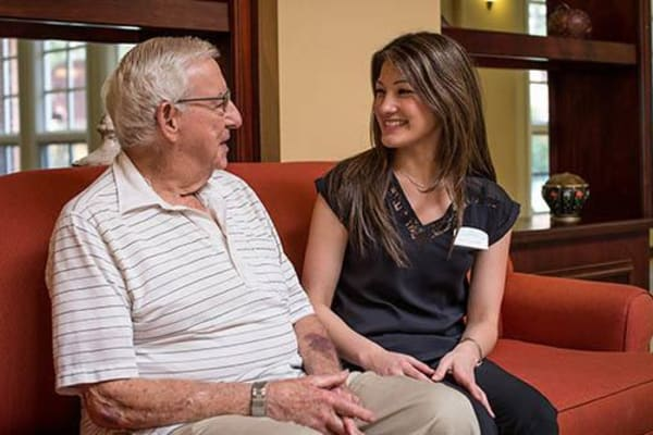 Caregiver talking with a resident at Pasadena Highlands in Pasadena, California