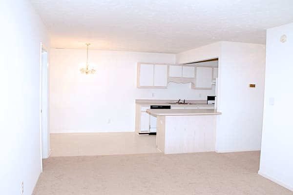 Kitchen and living room at Bone Creek Apartments in Fayetteville, North Carolina