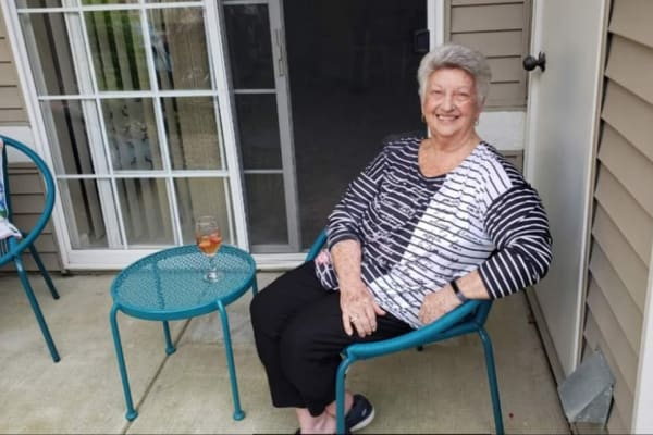 Resident Enjoying Outdoor Concert From Her Apartment