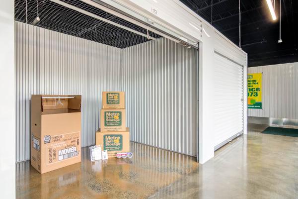 Indoor storage unit with roll up door at Metro Self Storage