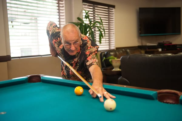 Man playing pool at Westmont Village in Riverside, California