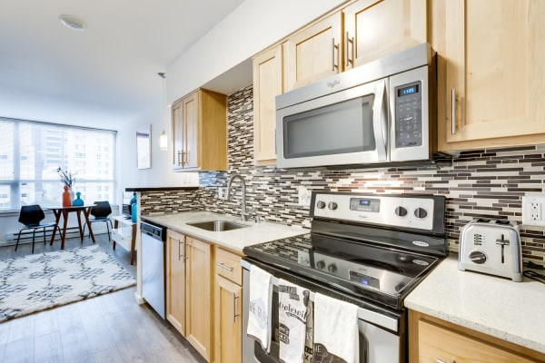 Bright and modern kitchen in model unit  at M Street in Seattle