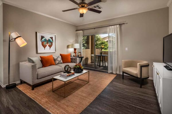 An inviting apartment living room at Colonnade at Sycamore Highlands in Riverside, California