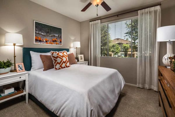 A well decorated master bedroom at Colonnade at Sycamore Highlands in Riverside, California