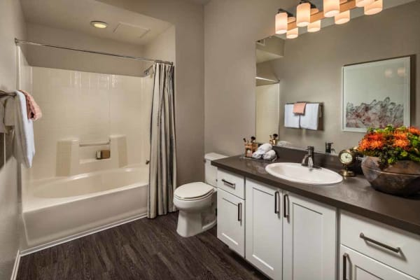 An attached master bathroom at Colonnade at Sycamore Highlands in Riverside, California