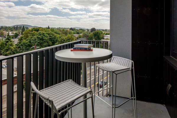 An apartment balcony with exceptional view at TwentyTwenty Apartments in Portland, Oregon