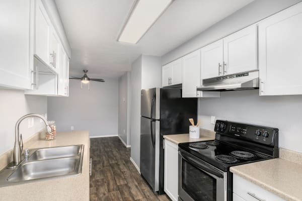 White Renovated Kitchen with stainless steel appliances at Walnut Grove Landing Apartments in Vancouver, WA