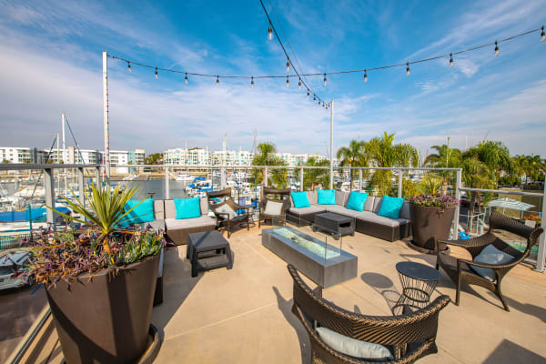 Patio area with fire pit feature at Harborside Marina Bay Apartments in Marina del Rey, California