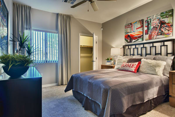 Master bedroom with ceiling fan at Avenue 25 Apartments in Phoenix, Arizona