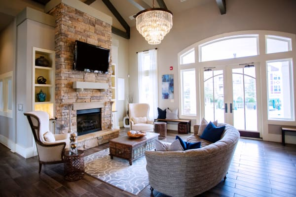 Spacious living room with a fireplace and an abundance of natural light at Berkshire Fort Mill in Fort Mill SC