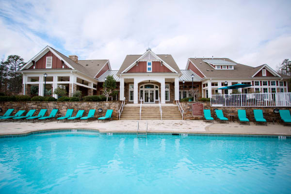 Outdoor pool and lounge chairs at  Berkshire Fort Mill in Fort Mill SC