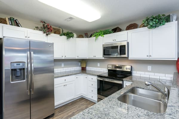 Upgraded kitchen with granite counter tops at The Landing of Clinton in Clinton, Iowa
