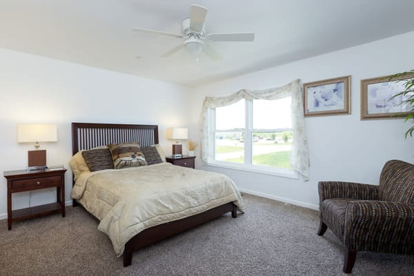A spacious bedroom at The Landing of Clinton in Clinton, Iowa
