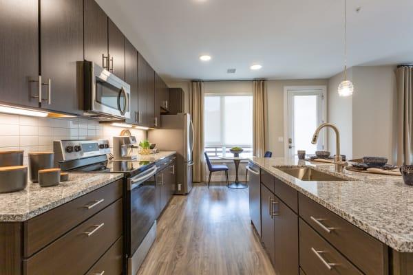 Sleek model kitchen at FalconView in Colorado Springs, Colorado