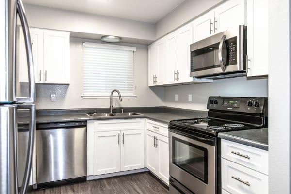 white model renovated kitchen at Bennington Apartments