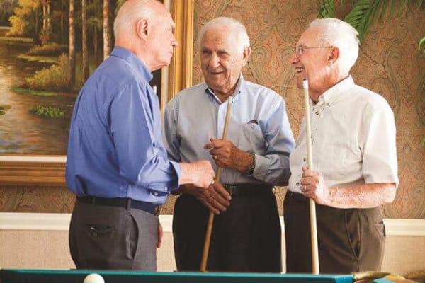Men playing pool at GreenTree At Westwood in Columbus