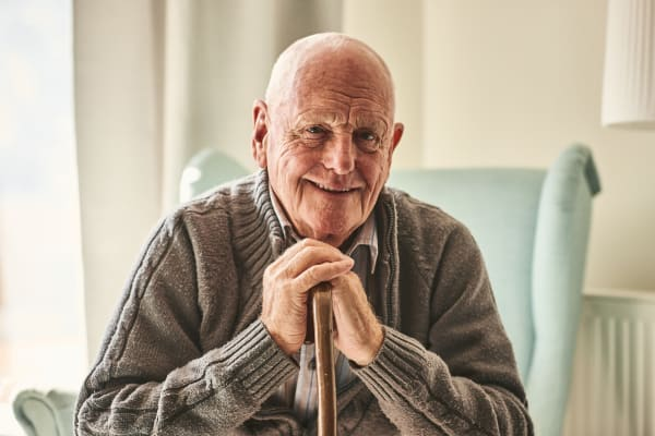 Resident smiling at the camera at Avenir Memory Care Westside in Los Angeles, California
