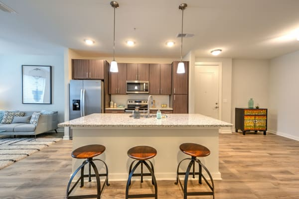 Modern kitchen and dining area at Luxor Club in Jacksonville, Florida