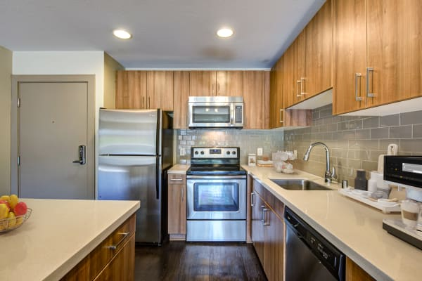 Kitchen with updated stainless steel appliances at Harborside Marina Bay Apartments in Marina del Rey, California