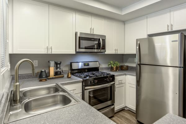 White Renovated Kitchen with stainless steel appliances   at Village Oaks in Chino Hills,