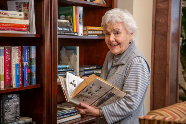 Resident of Capitol Ridge Gracious Retirement Living in Bristow, Virginia in the library